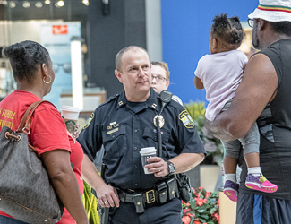 officer speaking with a family