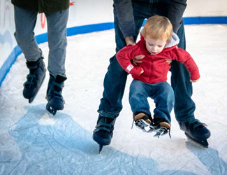 parents skating with young child