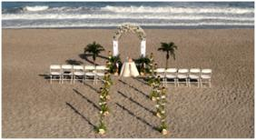 Image Of Arch And Chairs On Beach