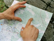 man's hands point on map
