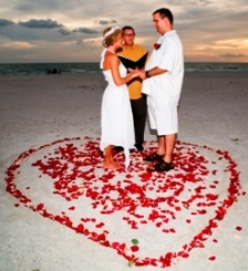 beach wedding in a rose petal heart