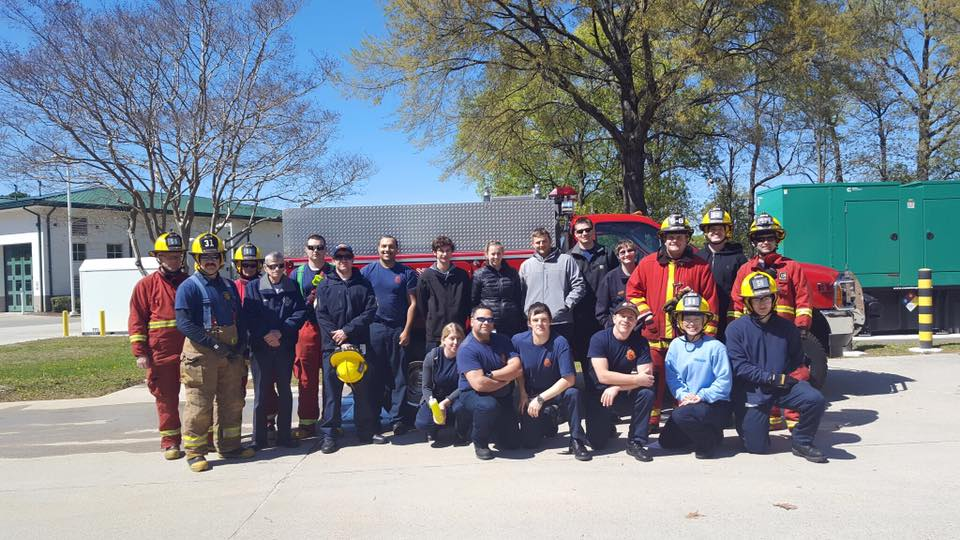 Volunteer firefighters with truck