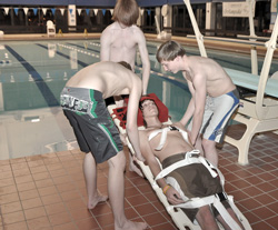 Boys assist injured swimmer