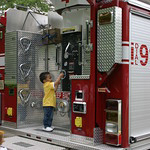 Child touching a Firetruck