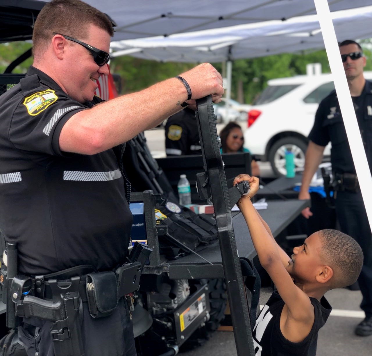 Officer interacting with a boy