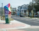 Accessibility improvements and ViBe Creative District neighborhood identifier (Artwork by Ruby Starcher)