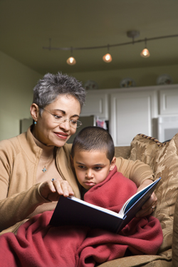 Grandmother reading book to child