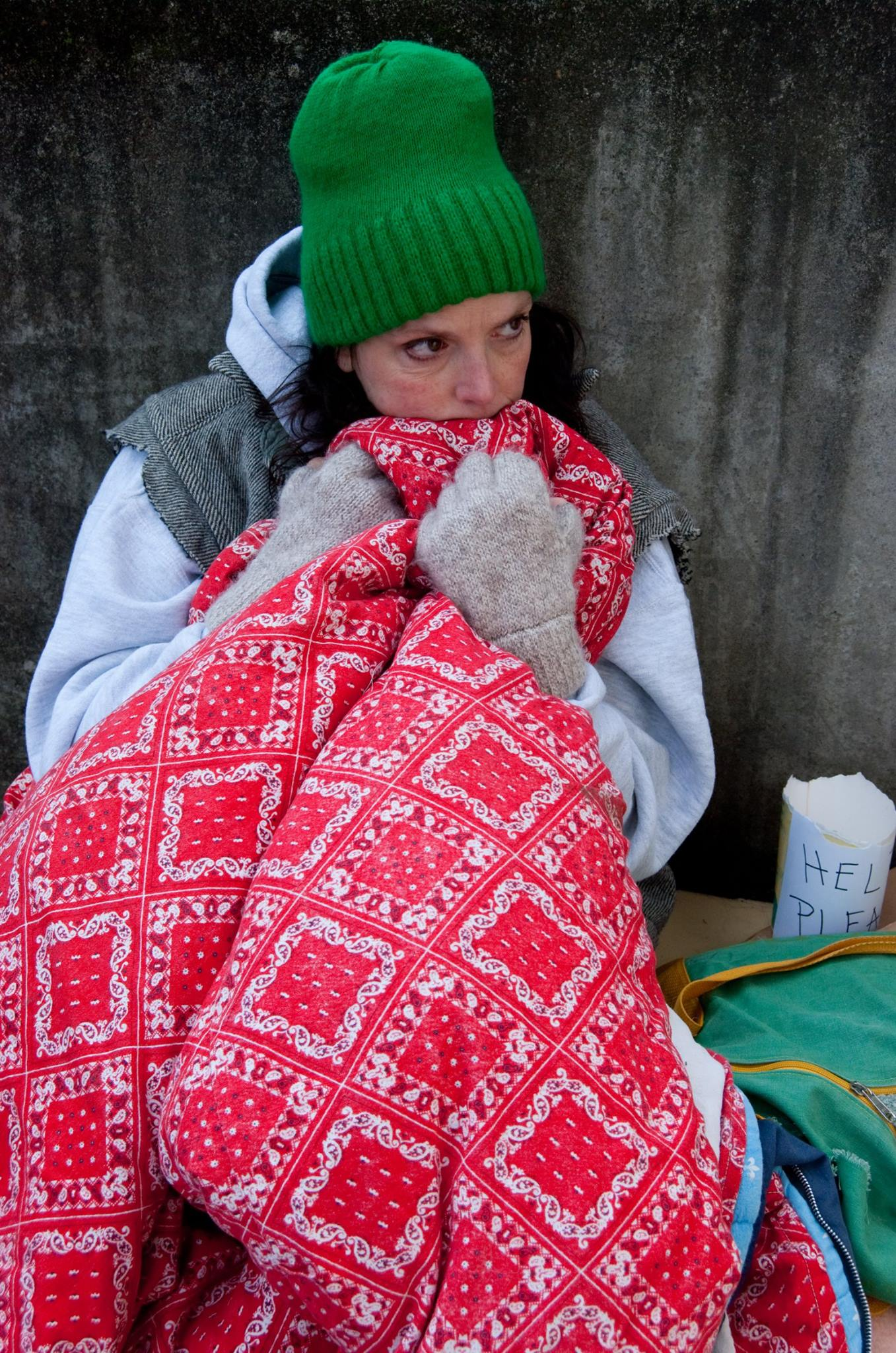 homeless woman with blanket